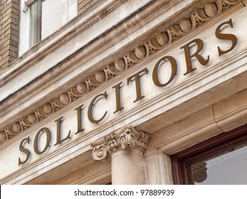 Solicitors sign on a office building