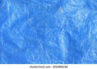 Solid blue tarp background with creases