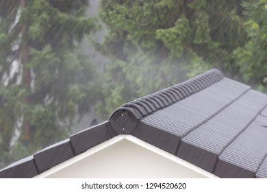 Solid house roof during storm and rain