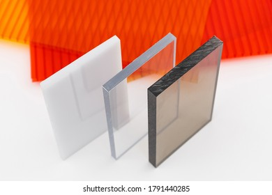 Solid Polycarbonate Sheet. Brown and transparent. Acrylic Plastic glass. Colored pc sheet on background
