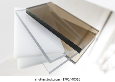 Solid Polycarbonate Sheet. Brown, white, transparent. Acrylic Plastic glass