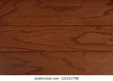Solid Red Oak Flooring with seam running horizontal.  Medium red stained.