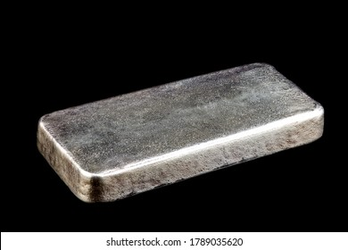Solid silver ingot isolated on a black background