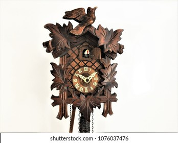 Solid woodcut carved antique cuckoo wall clock (1940's)