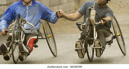 solidarity at handicap sport hand bike
