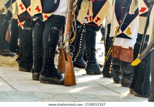 solidiers boots from behind at a reenactment involving early 1800s napoleon army