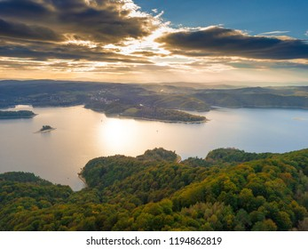 Solina lake in Bieszczady mountains in Poland at beautiful cloudy sunset. Aerial view on mountain lake.