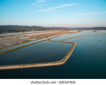 Soline in Slovenia at sunset, place of extraction of sea salt, aerial panoramic photo. Secovljske Soline.