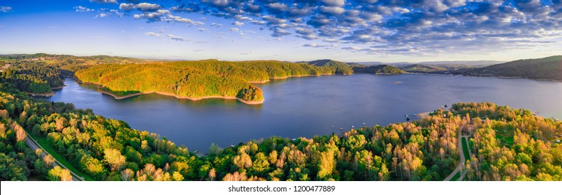 Solinskie lake in Bieszczady mountains in sunrise light. Aerial, drone photography.