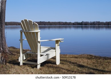 Solitary chair on a placid lake