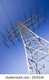 solitary electricity pylon - against a blue sky
