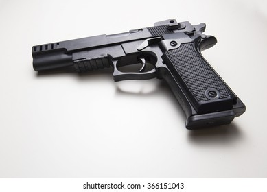 solitary gun on a white background