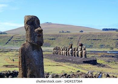Solitary Moai statue with the famous 15 Moai on the platform at Ahu Tongariki, Archaeological site in Easter Island, Chile, South America
