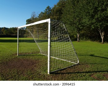 A solitary soccer goal at the end of the field