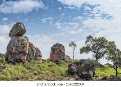 Solitary stones inserted in the African vegetation on the way to northern Angola. Soyo. Africa.