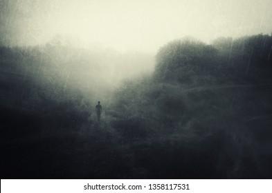 solitude concept, man walking alone and contemplating in rain, dark  surreal landscape