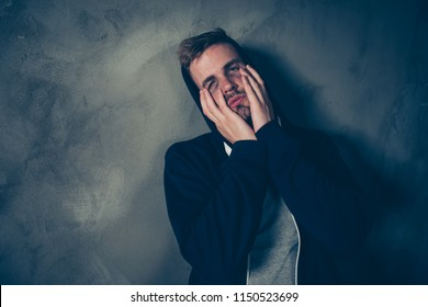 Solitude drugs taker people lifestyle bad life concept. Close up photo of sad unhappy scared frightened nervous weary exhausted tired guy holding hands on face doesn't know that to do