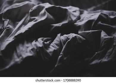 Solitude symbolized by an empty bed.