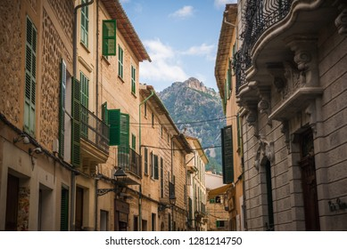 Soller, Mallorca, Spain - 04.11.2018: beautiful street view with traditional buildings in Soller city close to Serra de Tramuntana Mountains