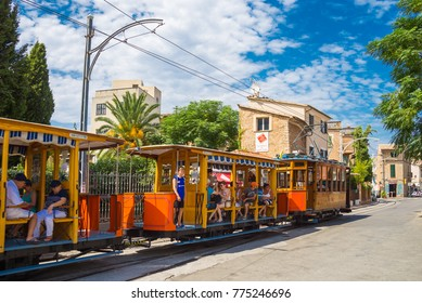 SOLLER, PALMA DE MALLORCA, SPAIN - AUGUST 29, 2017: Tourists ride on a tram in Soller, on a summer day.