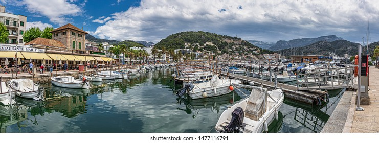 Soller, Spain - 26.05.2019: Panorama seafront and harbour at Port de Soller with yachts and boats