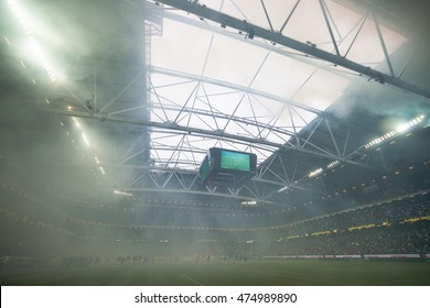 SOLNA, SWEDEN - AUG 28, 2016: Soccer derby between AIK and Hammarby in Allsvenskan at Friends arena. Visibility due to smoke wasnt that good the first half.
