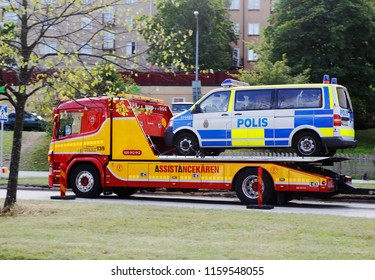 Solna, Sweden - August 31, 2016: Swedish police car loaded on a salvage truck.