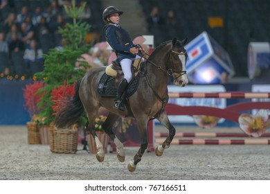 SOLNA, SWEDEN - DEC 1, 2017: Horse jumping for Ponys at the Sweden International Horse Show at Friends Arena.