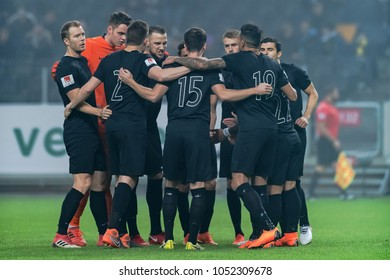SOLNA, SWEDEN, MARCH, 18, 2018: AIK players in a peptalk circle before the Svenska cupen semi final.