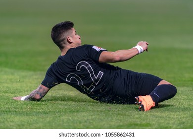 SOLNA, SWEDEN, MARCH, 18, 2018: AIK forward Nicolas Stefanelli sliding at the grass in the Svenska cupen semifinal. Djurgarden won with 2-0 and is in the final against Malmo FF