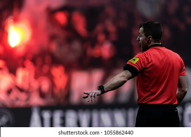 SOLNA, SWEDEN, MARCH, 18, 2018: Referee with tifo backdrop at the Svenska cupen semifinal. Djurgarden won with 2-0 and is in the final against Malmo FF