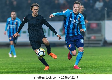 SOLNA, SWEDEN, MARCH, 18, 2018: Kristoffer Olsson (AIK) in duel with Fredrik Ulvestad (DIF) at the Svenska cupen semifinal. Djurgarden won with 2-0 and is in the final against Malmo FF
