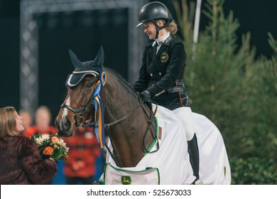 SOLNA, SWEDEN - NOV 24, 2016: Malin Baryard Johnsson at the Ride and drive competition in the Sweden International Horse Show at Friends arena.