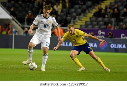 Solna, Sweden - November 20, 2018. Sweden national team midfielder Sebastian Larsson and Russia national team midfielder Ruslan Kambolov during UEFA Nations League match Sweden vs Russia in Solna.