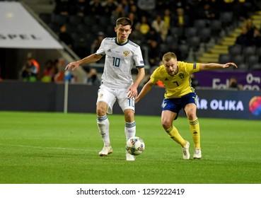 Solna, Sweden - November 20, 2018. Sweden national team midfielder Sebastian Larsson and Russia national team midfielder Ruslan Kambolov during UEFA Nations League match Sweden vs Russia in Solna.