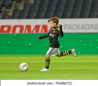 SOLNA SWEDEN - OCT 30, 2017: Junior soccer player from AIK kick the fotball. October 30 2017,Solna,Sweden