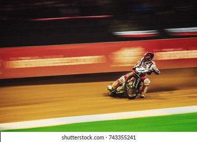SOLNA, SWEDEN - SEPT 23, 2017: Motion blurred speedway racers at the Stockholm FIM Speedway Grand Prix at Friends Arena in Stockholm.