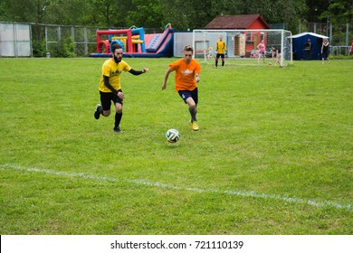 SOLNECHNOGORSK - JUNE 11: Men play football on a tourist base on June 11, 2017 in Solnechnogorsk, Moscow region, Russia.