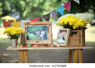 SOLO APRIL 2014 - Wedding planner is displaying couple's photographs in rustic design that set on the wooden table during wedding day party