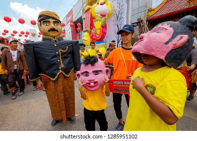 Solo, Central Java / Indonesia - February 11 2018 : Some people using the Ondel-ondel costume for Chinese New Year