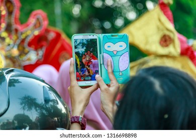 Solo, Central Java / Indonesia - June 22, 2014: Solo is known as one of the largest batik producing regions. People photographed the Solo Batik Carnival using their smartphone