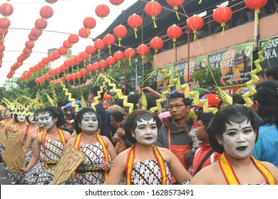 Solo Indonesia.  February 11th 2018.  Javanese comedy dancers with funny face,  Edan Edanan,  means crazy,  in public carnival,  welcoming Chinese New Year.