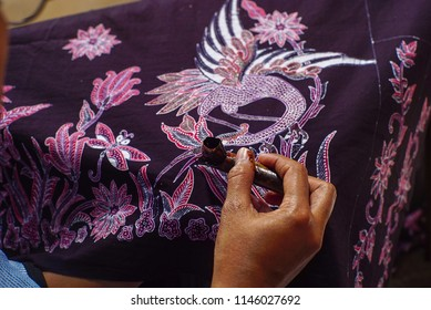 SOLO INDONESIA, JULY 31 2018 : Close Up Hand Painting Batik on the Fabric is a Indonesia Culture, Canting and Batik