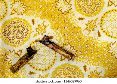 SOLO INDONESIA, JULY 31 2018 : Canting with gold batik background on the fabric