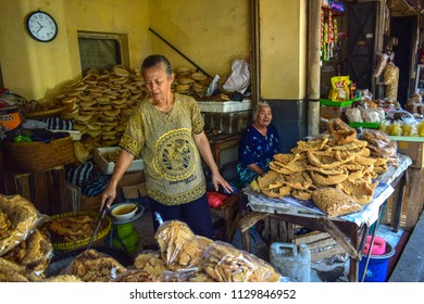 Solo, Indonesia - October 1st 2017 : One of seller Pasar Gedhe, Solo when frying Intip (Traditional food from Solo, Indonesia)