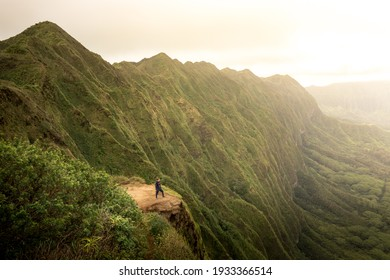 Solo woman model hiking at the summit of the Koolau mountain range on Oahu, Hawaii