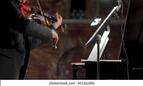 Soloist violinist in the church of saint caterina from siena in naples on an evening devoted to beethoven