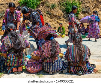 SOLOLA, GUATEMALA - MARCH 23, 2013: Guatemalan Mayan indigenous women in traditional clothing selling their products on the local market of Solola near Panajachel and the Atitlan Lake.