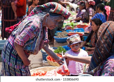 SOLOLA, GUATEMALA- MAY 10: An unidentified woman buys vegetables at traditional weekly market in Solola), Guatemala on 10 May 2013.