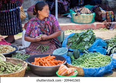 SOLOLA, GUATEMALA- MAY 10: An unidentified woman sells vegetables at traditional weekly market in Solola), Guatemala on 10 May 2013.